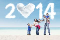 Happy family celebrate new year at beach Stock Illustration