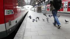 A passsenger on railroad station platform - stock footage
