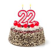 birthday cake with burning candle number 22 - stock photo