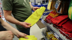 Fitting rubber gloves in the store - stock footage