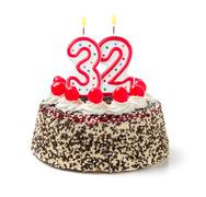 birthday cake with burning candle number 32 - stock photo