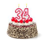 birthday cake with burning candle number 34 - stock photo