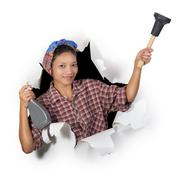 Woman holding cleaning supplies in a paper hole Stock Photos