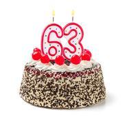 birthday cake with burning candle number 63 - stock photo