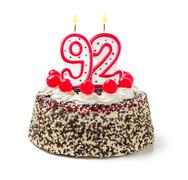 birthday cake with burning candle number 92 - stock photo