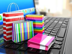 E-commerce. online internet shopping. laptop and shopping bags. Piirros