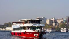 Bosporus tour boat sails into Port of Goldenhorn Stock Footage