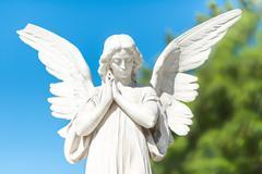 Beautiful angel on a clear blue sky Kuvituskuvat