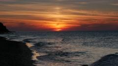 Beautiful painted sunset or sunrise sky over beach (Ultra HD, UHD, 4K) Stock Footage