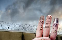 Finger is captive with prison wall in background Stock Photos