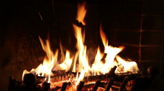 Fire burns in a fireplace - stock footage