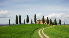Rural house and cypress avenue, typical landscape of Tuscany, Italy - stock footage