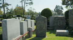 Cemetery Daytime Day Tombstones Grave RIP Driving Tombs Stones - stock footage