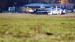 Plane on the field, preparing for take-off Stock Footage