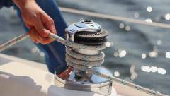Closeup yachtsman tying sail ropes, sailing, yachting, sport, click for HD Stock Footage