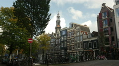 Historic houses in Amsterdam on canal Stock Footage