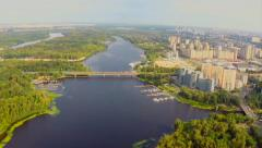 Panorama of green majestic island in wide river, city aerial, click for HD Stock Footage