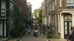 Narrow street in old city Amsterdam Stock Footage