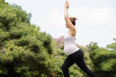 pregnant woman mother belly relaxing park yoga meditation - stock photo