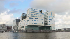 Modern office building on waterfront Stock Footage