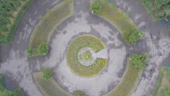 Aerial vertical shot of flower-bed in park, extreme circling, click for HD Stock Footage
