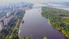 Aerial vertical shot of city park and beautiful wide river, click for HD Arkistovideo