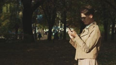 Young woman browses her smartphone. Distance from other people. Stock Footage