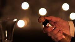 Champagne cork popping out of the bottle. - stock footage