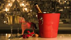 Ice bucket with bottle of wine, two wineglasses and a toy horse. Stock Footage