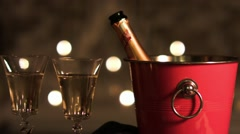 Ice bucket with sparkling wine and two wineglasses. Still frame. Stock Footage