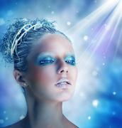 winter makeup of a beautiful woman - stock photo