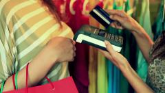 Woman paying using credit card for her shopping Stock Footage