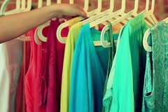 Woman picking clothes from hanger in the boutique Stock Footage