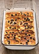 rustic traditional british bread and butter pudding - stock photo