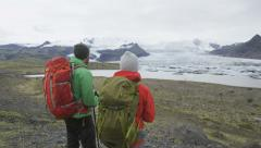 Hiking adventure travel people on Iceland Stock Footage