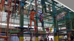 Kids play extreme sports in a shopping mall in Chengdu, Sichuan, China Stock Footage