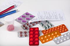 table with prescriptions and pharmaceuticals - stock photo