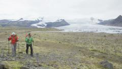 Hiking adventure travel people walking on Iceland - active healthy lifestyle Stock Footage