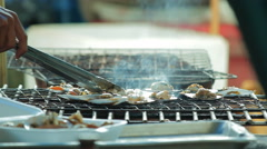 Grilled scallops topped with butter, garlic and parsley on flaming grill. Stock Footage