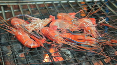 Seafood kebabs with gourmet shelled fresh prawns roasting over the fire on a por Stock Footage