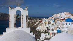 Santorini Oia - Pan from Bell towers to Blue Domed Buildings Stock Footage