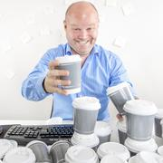 Business man drinks too much coffee Stock Photos