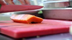 Mexico, 2014: CLOSE UP-HANDHELD SHOT. Papaya chunks being cut. Stock Footage