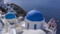 Santorini Oia - Tilt down from blue sky to Blue Domed Buildings Stock Footage