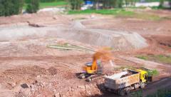 Excavator Loads a Truck, Tilt-Shift Time Lapse Stock Footage