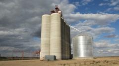 Grain elevator with dramatic clouds. Saskatchewan, Canada. Stock Footage