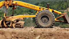 Stock Video Footage of Big road grader on the construction site