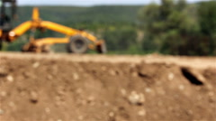 Construction site road grader working on soil Stock Footage