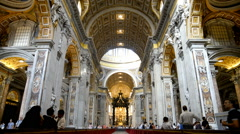 Indoor view of Basilica di San Pietro in Rome, Italy, beautiful gold finishing Stock Footage