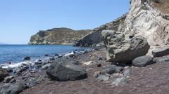 Santorini Red Beach - Slow pan from White beach, across the sea, to Red Beach Stock Footage